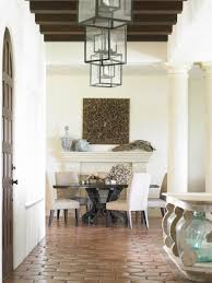 Arched Door In Inspiring Beach Style Dining Room Design With Circular Table And Fireplace Mantel Also Decorating Lanterns White Pillars Plus