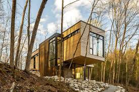 100 Cantilever House Escape To This ModRustic Ed In The Woods