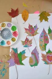 Children Paint Dried Leaves And Wrap Twigs With Yarn To Make Beautiful Mobiles