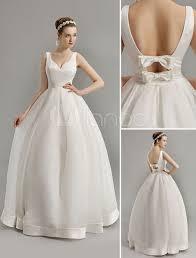 vintage inspired plunge v neck wedding gown with bow embellished