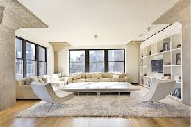 Living Room Centered Around A Massive Low Slung Coffee Table With Pair Of
