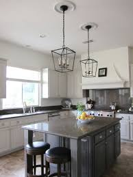 two recessed lights slightly center kitchen island lighting