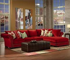 gorgeous red sectional living room set with decorative throw