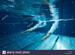 Two Female Swimmers Dive Start In An Open Air Olympic Swimming Pool France Underwater View