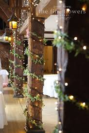 The pillar uprights at the Tithe Barn in great Fosters decorated