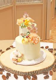 Two Tiers With A Textured Buttercream Covered In Variety Of Sugar Flowers