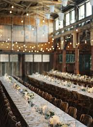 Wedding Receptions In A Barn With Hanging Lights And Candles For Rustic Themed Ideas