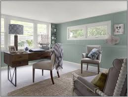 Office Rustic Home Interior Decor With Blue Wall Painted Also Classic Wooden Table Plus Corner Built In Shelves And Drum Lamp
