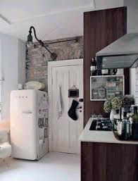 White SMEG Fridge In And Wood Rustic Kitchen