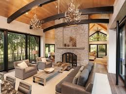 Elegant Antler Chandeliers And Grey Leather Sofa With Stone Contemporary Rustic Living Room Fireplace For Moder