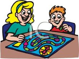 Brother And Sister Playing A Board Game