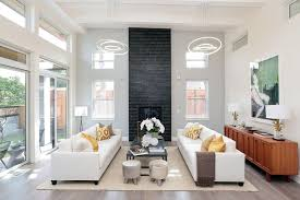 Contemporary Living Room With High Ceilings And Modern Light Fixtures