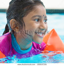 Indian Girl Learning Swimming In Pool Asian Child Swimmer Class With Float Bands