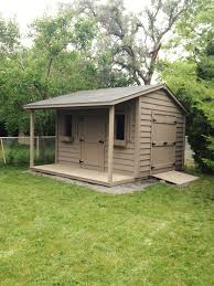 Tin Shed Highland Il 12 u0027x16 u0027 lap sided garden shed with 10 12 pitch roof and 8 u0027x7