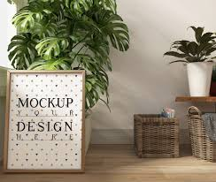 modellplakat im modernen weißen wohnzimmer mit monstera