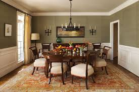 Calming Dining Room Design With Grey Wall And White Chair Round Shape Wooden Table Also Orange Floral Rug Decor Idea