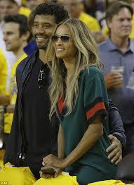 ciara and wilson sit courtside at seven of the nba