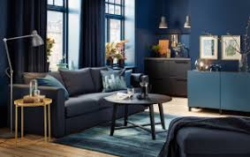 Small Dark Blue Living Room With Black Sofa And Round Coffee Table