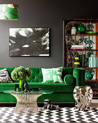 Green Velvet Sofa Against Black Wall