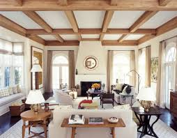 white living room with wood ceiling beams living rooms