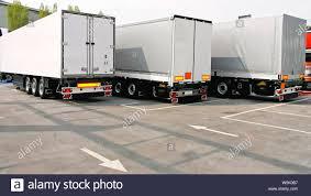 100 Semi Truck Trailers Three At Parking Lot Stock Photo