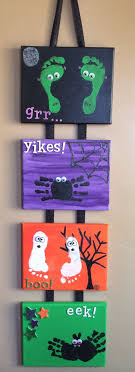 halloween diy craft with kids hand and foot print canvas