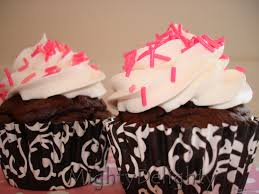 Chocolate cupcakes Vanilla frosting with pink sprinkles