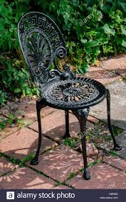 Wrought Cast Iron Chair In The Garden Black Color Stock ... 42 Black Metal Outdoor Fniture Ding Phi Villa 300lbs Wrought Iron Patio Bistro Chairs With Armrest For Genbackyard 2 Pack Wrought Iron Garden Fniture Mainstays 3piece Set Gorgeous Patio Design Using Black Chair And Round Table With Curving Legs Also Fabric Arlington House Chair Commercial Sams Club 2498 Slat At Home Lck Table2 Chairs Outdoor Gray Mesh Back