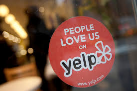 The Yelp Logo Is Displayed In Window Of A Restaurant New York