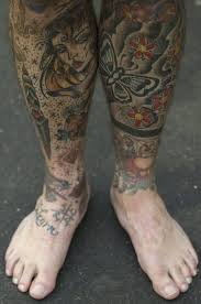 A Man Poses To Display His Leg Tattoos During The Great British Tattoo Show In Alexandra