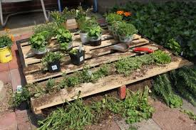 This Pallet Garden Bed Is Shown Being Used On A Patio Which Unique Idea All You Have To Do Lay The Out Horizontally Fill It With Dirt