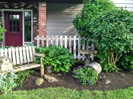 Spring Flowerbed With A Rustic Bench And Bucket Full Of Dumped Flowers Funkyjunkinteriors