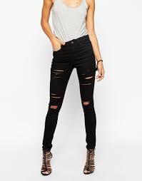 khloe kardashian flashes flesh in torn skinny jeans as she catches