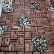ikea decking squares for using in the bathroom with rocks under