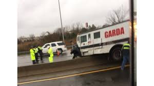 Armored Truck Crashes On I-64, Spilling Money