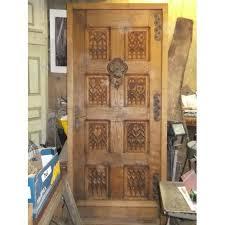 porte d entrée style gothique chêne massif entièrement sculptée