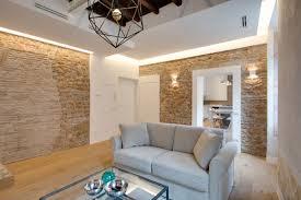 Via Sistina Apartment Stone Walls In Living Room