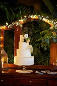 White Wedding Cake Decorated With Greenery And Flowers Mexican