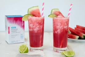 Landscape View Of Two Tall Glasses Shaken Watermelon And Passion Tea With Pink Striped Straws