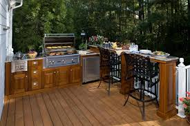 Gorgeous Outdoor Kitchen Design With Wooden L Shaped Cabinets Wrought Iron Chairs Also Deck Ideas