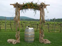 Decorated Wedding Arch With Burlap And Sunflowers Perfect For A Country Designed By