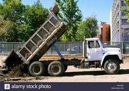 Dump Truck With Raised Bed Dumping Dirt Stock Photo: 6982268 - Alamy Landscape Dump Truck Bodies Picture 15 Of 50 New Beds For Nor Cal Trailer Sales Norstar Bed Flatbed Industrial Alinum Steel Heritage Liners Best Resource Building A With Front Loader Book Shelf 7 Steps Pup Trailers By Download Channel