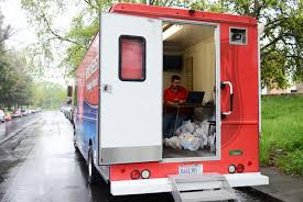 Gregory Dean Works Inside A Salvation Army Truck At Their Food D