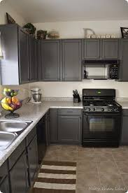 how to decorate a kitchen with black appliances and dark gray