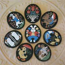 Primitive Easter Tree Decorations by 10 Easter Egg Inspired Cross Stitch Patterns