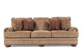 mathis brothers sofa and loveseats nailhead accented 101 sofa in desert brown mathis brothers