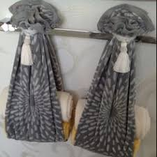 Decorative Towels For Bathroom Ideas by Love This Idea Use A Scarf To Tie Up Display Towels In The Bath