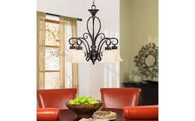 A Downlight Chandelier Lights Round Dining Room Table