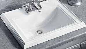 double undermount kohler bathroom sinks under two framed mirrors