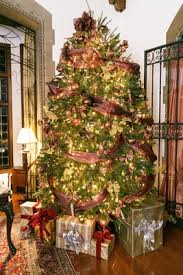 Holiday Wedding At The Pleasantdale Chateau With A Christmas Tree Ribbon Golden Lights